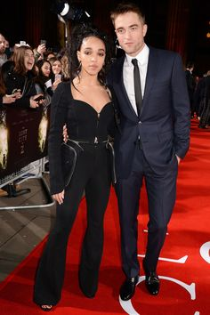 Robert Pattinson wore a traditional suit with a skinny tie while girlfriend FKA Twigs wore Givenchy by Riccardo Tisci and Shaun Leane earrings.
