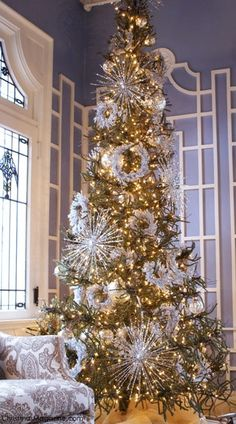 Holiday decorating - Gold and white Christmas tree with retro-inspired ornaments.