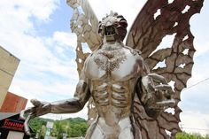 Discover Mothman Statue in Point Pleasant, West Virginia: This red-eyed chrome beast pays homage to the popular modern myth of West Virginia's insectoid monster. Mothman Sightings, Mysterious Places, Walk In The Woods, Conspiracy Theories, West Virginia, That Way, Statue Of Liberty, Stuff To Do, Beast