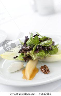 Gourmet salad dish in an upscale restaurant restaurant. Vertical shot.