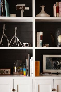 SallyL: Design Sponge - Luster NYC - Crisp white bookcases with charcoal painted brick backing. ...