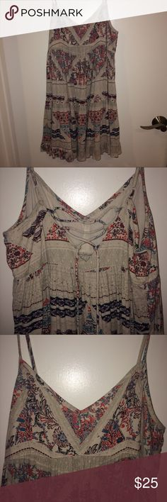 Babydoll American Eagle dress Great material for summer. Ties up in the back. Can fit a Small. Worn only a few times and in new condition! American Eagle Outfitters Dresses
