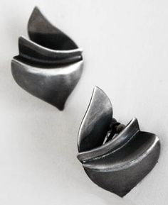 """Art Smith American, c 1950's Earrings Silver Signed 1 3/4 x 1. One of the leading modernist jewelers of the mid-twentieth century, Smith trained at Cooper Union. Inspired by surrealism, biomorphicism, and primitivism, Art Smith's jewelry is dynamic in its size and form. Although sometimes massive in scale, his jewelry remains lightweight and wearable. See """"From the Village to Vogue: The Modernist Jewelry of Art Smith""""."""