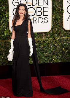 Fabulous: Amal channeled Audrey Hepburn in a strapless Dior Couture black gown, white gloves and a clutch