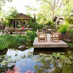 A deck extends from the shore of a manmade pond.