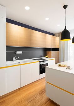 Bulgaria Apartment Features Sunny Pops of Yellow | Home Design Lover Yellow Apartment kitchen island