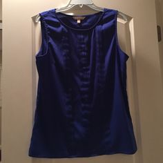 Banana Republic Sleeveless Top Size Large Check out this gorgeous Royal Blue Top by Banana Republic. It is made of 100% polyester and can be machine washed cold. This top will be a great addition for a work wardrobe. Since it's Royal Blue it can be matched with a black suit or if going casual with a pair of white cropped pants. Happy looking. This top has only been worn once. Banana Republic Tops Blouses