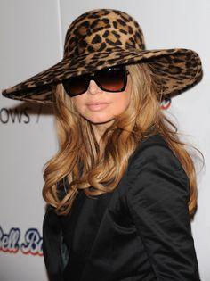Fergies trendy hat hairstyle