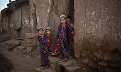 A beautiful photograph of Afghan refugee girls dressed in new clothes to celebrate Eid al-Adha in a poor neighborhood on the outskirts of Islamabad, Pakistan