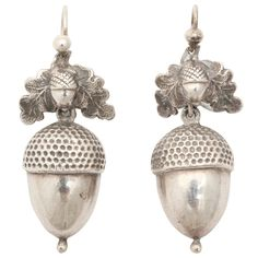Victorian Silver Acorn and Oak Leaf Dangle Earrings. Victorian silver acorn earrings have always had high demand and we have purchased a pair of the realistic looking acorns in a larger than usual size. The engraving is realistic and admirable. The earrings are light on the ear being hollow and good for the heart, bringing with them their legend of rebirth and fertility