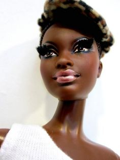 OMG... I put lashes on my daughter's barbie last yr. They're not blk Barbies though. :) Too cool. Love it
