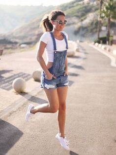 overalls and white crop top and sneakers                                                                                                                                                      More
