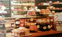Pound cakes, muffins, cupcakes on and behind main register counter.
