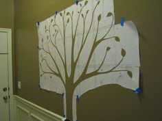 <3 this!! Doing this in the hallway.  Family Tree Photo Wall - A Vision Realized