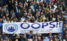1399824570972_lc_galleryImage_Manchester_City_fans_hold.JPG (574×356)