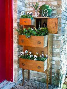 Take your porch or patio plants to new heights with an old dresser, chest of drawers or vanity.