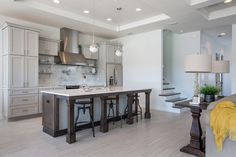 Rectangular kitchen island with bar stools