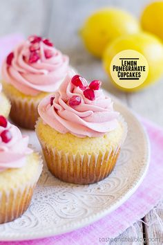 Lemon cupcakes are topped with a light pomegranate frosting and fresh pomegranate seeds in these light and refreshing Lemon Pomegranate Cupcakes.::