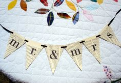 Mr. and Mrs. wedding pendent banner recycled book paper, wedding bunting. $25.00, via Etsy.