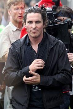 Christian Bale very wet.
