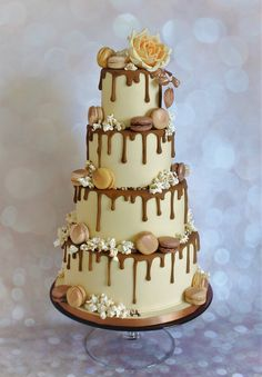 Caramel Drip Wedding Cake with Macarons, Popcorn and Large Orange Sugar Rose with Rose Gold Leaves