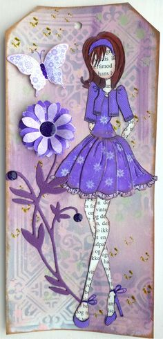 Pretty in Purple - Evie's Prima Doll tag using patterned fabrics and book text. Prima Paperdoll Club at Simple Pleasures.