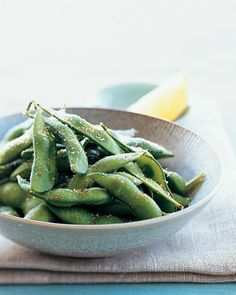 Edamame disappear quickly when simply salted, but they take on added appeal when tossed with chile flakes. Boil them and set them out while you put the finishing touches on the meal.