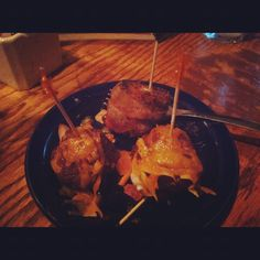Bacon wrapped blackened grouper (fish) and in house BBQ meatball with melted drizzled cheese on top at Crazy Horse in #btown #dishcrawl #Restaurants