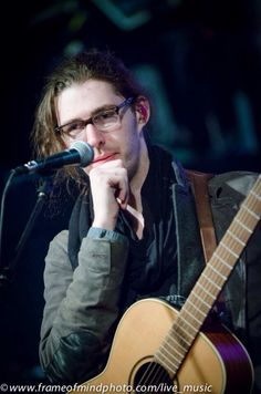 My personal favorite photo,  I love a man in thought with glasses.  The guitar does not hurt either.