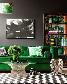 The green sofa is the main focus here but I like the way green is continued into the bookcase, lampshade and furnishings - a way of using Pantone's Colour of the Year, Greenery.