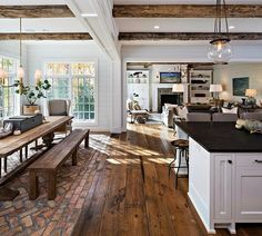 Love the dark floor paneling, white walls a faux wood beams in the ceiling!