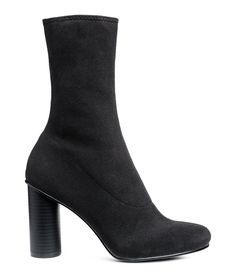 Check this out! Ankle boots in a form-stitched knit with a high leg section and round heels. Faux leather insoles and rubber soles. Heel height 4 in. - Visit hm.com to see more.