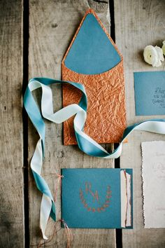 Turquoise and Copper Wedding Invitations   photography by http://www.kristynhogan.com