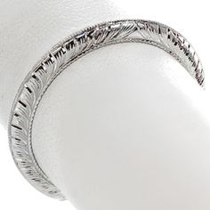 The Hand Engraved Knife Edge Band is a beautifully simple wedding band that sports all hand engraving and some milgrain. Shown here in 14K white gold