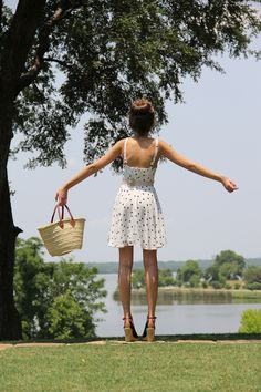 the summer outfit - a sundress, wedges, and woven straw bag. simple.