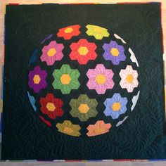 Made by Brit S using my pattern http://www.romanianquiltstudio.com/english/flower-sphere-quilt-pattern.htm