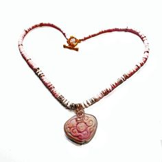 Valentine Gift, Heart Pendant, Carved Pendant, Luhuanus Shell, Heishi... ($65) via Polyvore featuring jewelry, pendants, carved pendant, pink pendant, charm pendant, native american beaded jewelry and seashell pendant