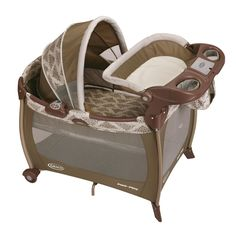 Graco Silhouette Pack n Play Collection This cozy oval bassinet