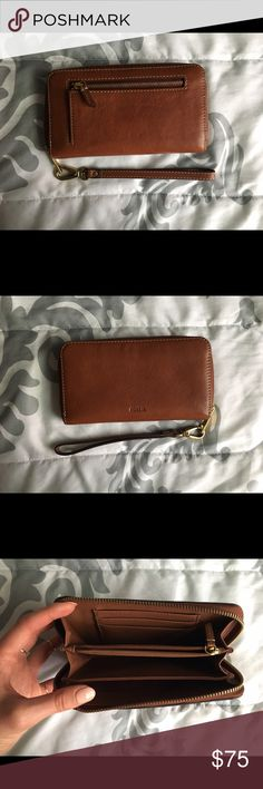 Fossil Emma RFID zip clutch Classic leather clutch from fossil in brown. It's as new, I still have the receipt. Please feel free to ask any questions (: Fossil Bags Clutches & Wristlets