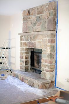 Most up-to-date Pictures whitewash Stone Fireplace Ideas Stacked stone fireplaces are undeniably gorgeous and can turn what would otherwise be a plain, borin Whitewash Stone Fireplace, White Stone Fireplaces, Painted Stone Fireplace, Stone Fireplace Makeover, Wooden Fireplace, Paint Fireplace, Home Fireplace, Fireplace Inserts, Fireplace Makeovers