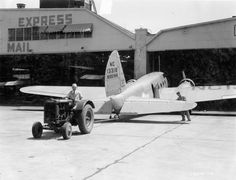 McCormick-Deering I-12 Tractor Pulling Boeing Mail Airplane   Photograph   Wisconsin Historical Society