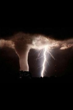 Lightning strike and a tornado in the night sky. Absolutely breathtaking.