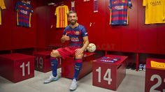 Arda Turan wearing the new Barça shirt | FC Barcelona