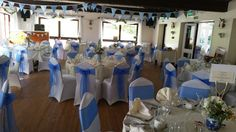 Hornsbury Mill, Royal Blue organza sashes and Ivory chair covers.