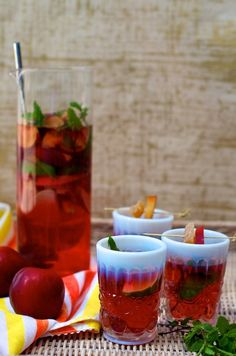 Ginger Plum Sangria: 1 bottle rose wine, 1 1/2 c. ginger ale, 1 pureed plum, fresh mint, sliced plum, apple, and lime.