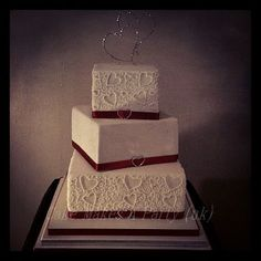 Square Wedding Cakes - Piped wedding cake to match invites  Bottom tier red velvet cake with white chocolate ganache  Middle tier vanilla cake with milk chocolate ganache  top tier vanilla cake with dark chocolate ganache