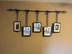 Curtain rod with pictures hanging from ribbon