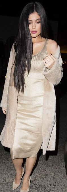 Kylie Jenner: Coat – Karl Donaghue  Bracelet – Cartier  Shoes – Gianvito Rossi  Iphone case – Boostcase