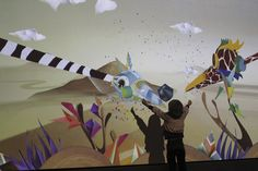 Puppet Parade is an interactive installation that allows children to use their arms to puppeteer larger than life creatures projected on the wall in front of them. Children can also step in to the environment and interact with the puppets directly, petting them or creating food for them to eat.