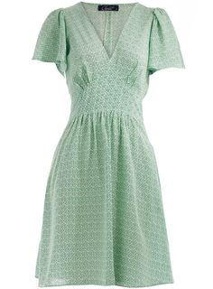 Green leaf print dress with flared sleeves and tie back detail. 100 viscose. Machine washable.